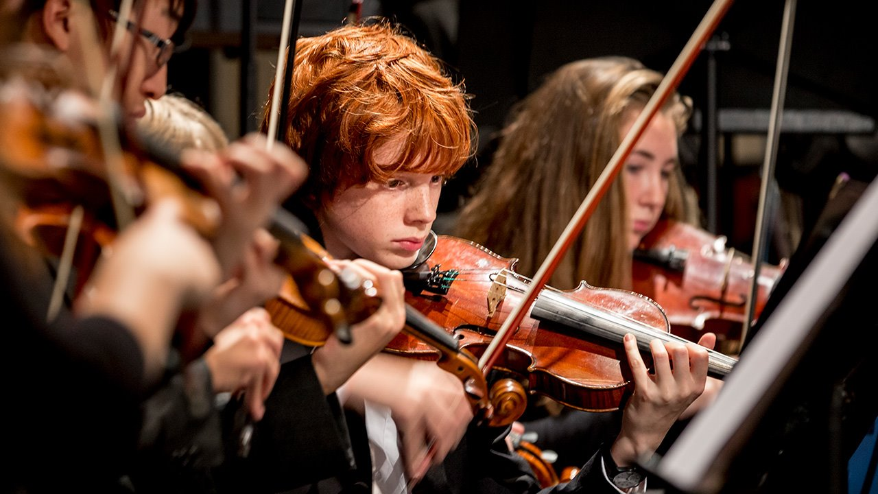 Music-at-Brighton-College-Strings-with-pupils.jpg