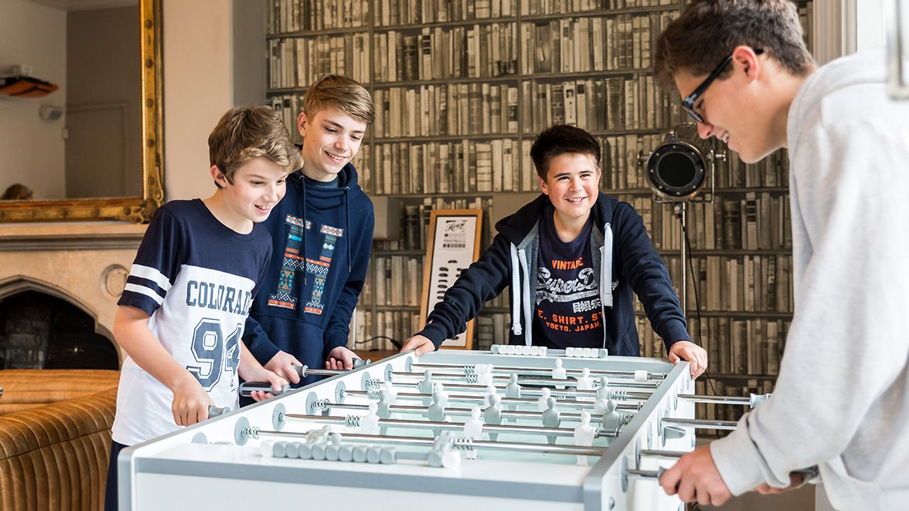 Boys-boarding-playing-table-football.jpg