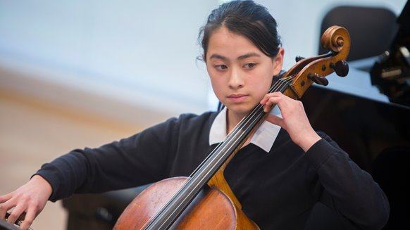 Riya playing cello.jpg